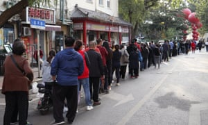 Residents line up to be tested for Covid-19 on Monday, as part of a mass testing programme following a new coronavirus outbreak in Qingdao, in China's eastern Shandong province.