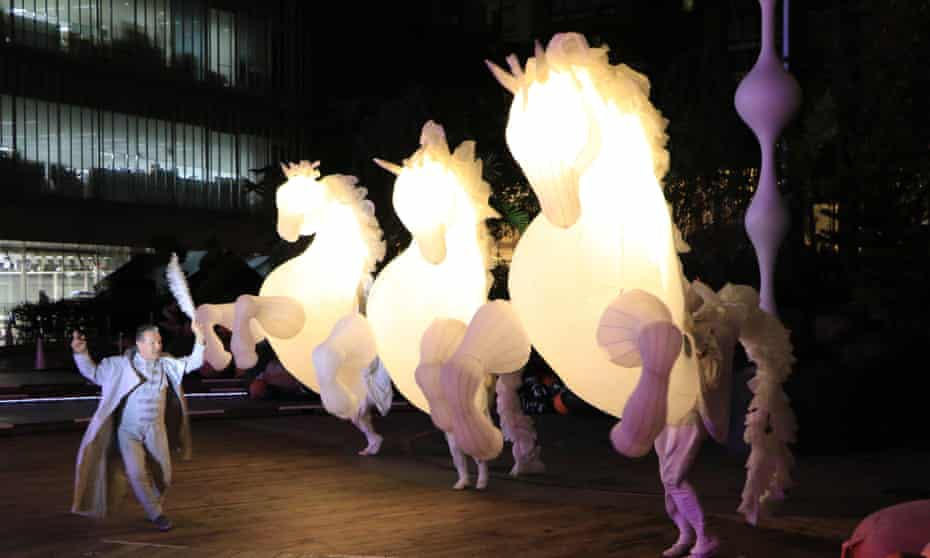 "Members of French performance group Compagnie des Quidams perform ""FierS a Cheval"" at a press preview of the Roppongi Art Night 2016 in Tokyo"