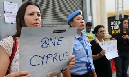 UN blue berets watch peace protests at the buffer zone in Nicosia this month.