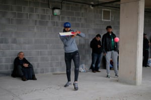 Seeing as there's no action on the pitch some of the Pakistan fans play an improvised game under the stands.