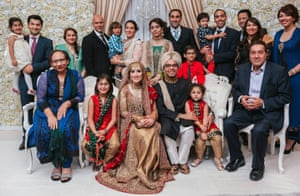 Saima (back row, centre, holding her son, Ben) at her cousin's wedding, September 2015. Mir's parents sit at either end, front row; back row: her sister Javaria (third left), brothers Zafar and Khizer (8th and 10th from left), and sisters Fozia and Khola (far right).
