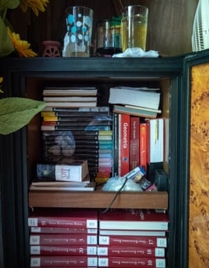 A refrigerator turned into a book storage in the living room of the Utuado family without power since Hurricane Maria's path.