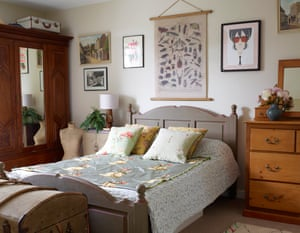 The couple's bedroom, with an embroidered silk offcut on the bed.