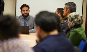 Syrian refugees attend an employability workshop at Coventry central library