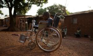 Giovanni Mougounou, 10, near his home in Bangui