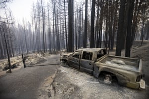 A charred pickup truck whose wheels melted in the blaze