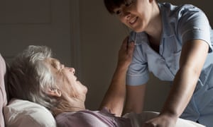 Care assistant with older woman