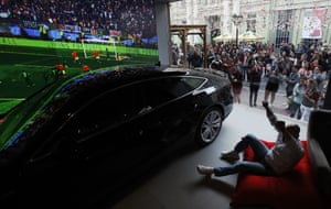 People celebrate after Russia scored their fifth goal when watching the opening match between Russia and Saudi Arabia in a car dealership in Moscow, Russia,