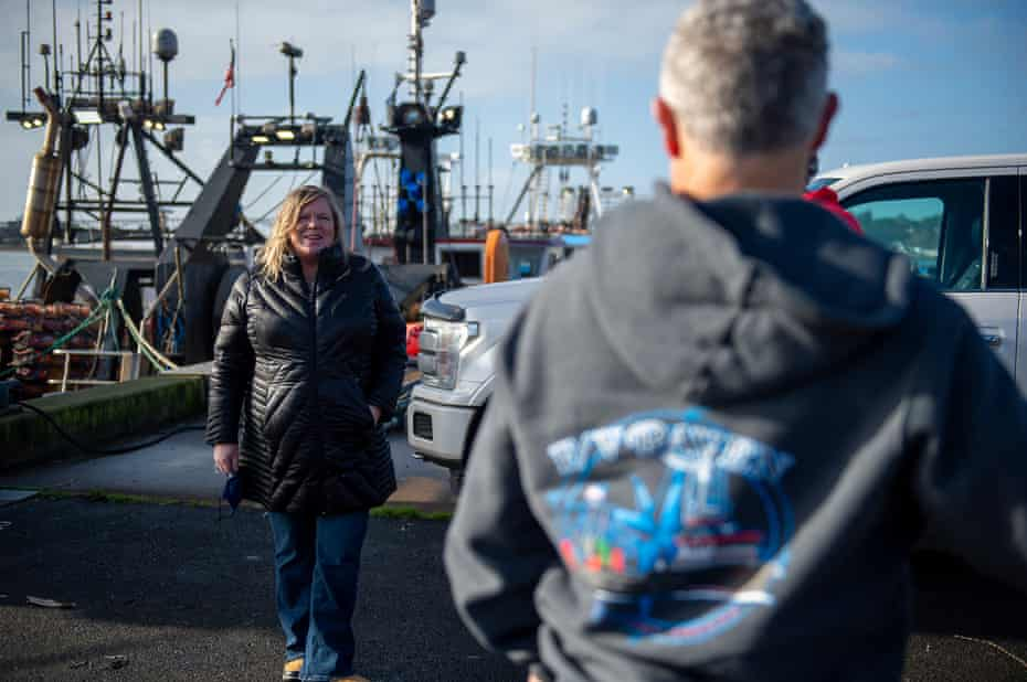 Heather Mann, the executive director of the Midwater Trawlers Cooperative talks with boat owners in Newport, Oregon, on 8 January.