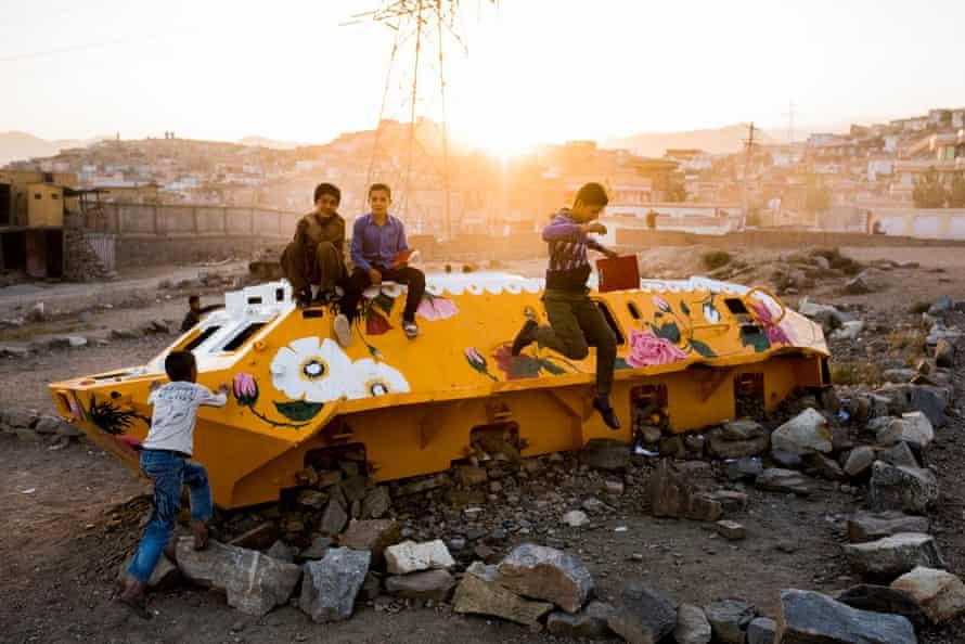 Kids play on the Soviet-era tank which Taiyebi painted