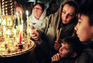 Orthodox believers light candles to celebrate Christmas in Baku, Azerbaijan