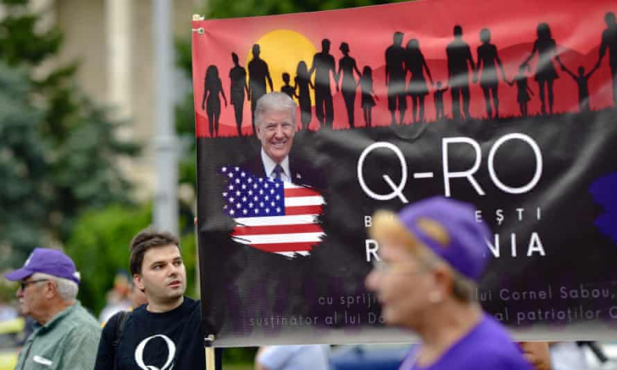 Romanian supporters of QAnon take part in a rally against the government's measures to prevent the spread of Covid-19 infections in Bucharest, Romania.