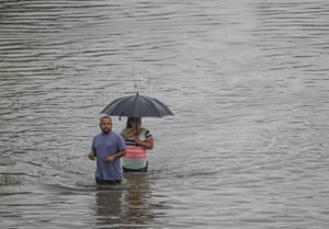People wade through the flooded Hopper Road on 19 September 2019 in Houston, Texas.