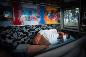 Jorawar Singh sleeps in the cabin of his truck