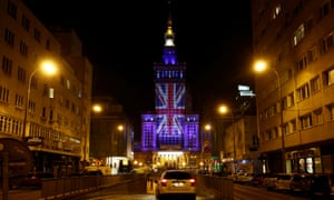 Warsaw's Palace of Culture and Science illuminated in union flag colours the day before the EU referendum