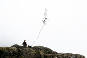 An abseil is set up. The large group of botanists, geologists and mountaineers spent last week dangling from ropes to survey unexplored areas of the exposed and often sheer north face of Ben Nevis in a search for mountain species.