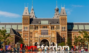 The Rijksmuseum and IAmsterdam sign and the facade of the Rijksmuseum after the 2014 renovations; seen on a sunny summer day with blue sky.