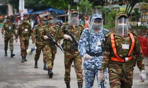 Troops patrol Shahbagh, a neighbourhood in Dhaka, during lockdown.