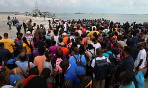 People wait in Marsh Harbour Port to be evacuated to Nassau, in Abaco on Friday. The evacuation is slow and there is frustration for some who said they had nowhere to go after the Hurricane Dorian splintered whole neighborhoods. (AP Photo/Gonzalo Gaudenzi)
