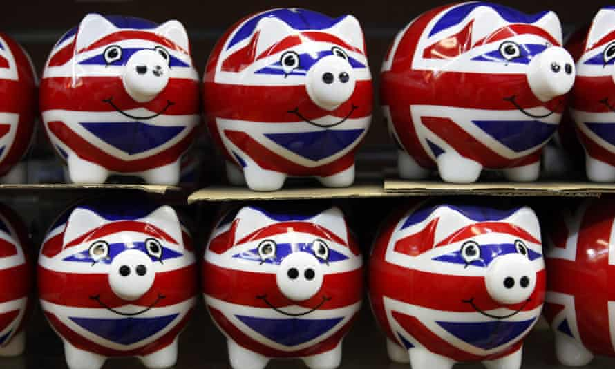 A row of souvenir Union Jack piggy banks in a shop on Oxford Street