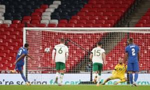 Dominic Calvert-Lewin sends Darren Randolph the wrong way to score England's third goal .