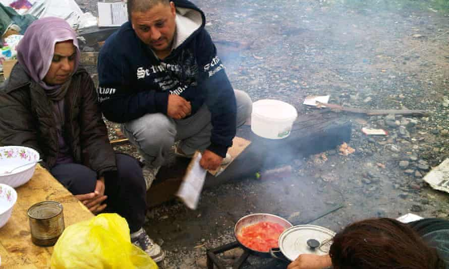 Mushda and Samir Zehang, Iraqi Kurds from Kirkuk, cooking outside their tent pitched opposite Idomeni train station.