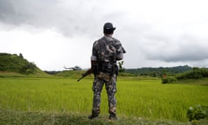 A Myanmar soldier stands near Maungdaw