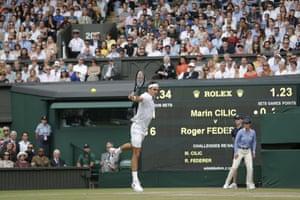 Roger Federer returns.