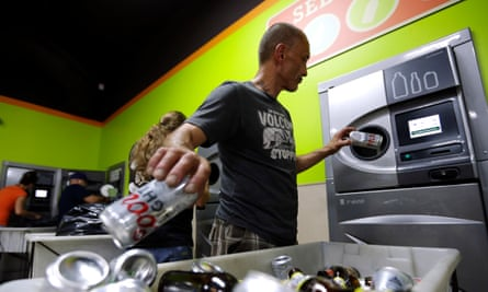 A man returns drinks containers to a bottledrop center in Gresham, Oregon