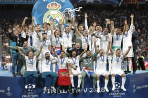 Real Madrid's Sergio Ramos lifts the trophy as his team-mates celebrate.