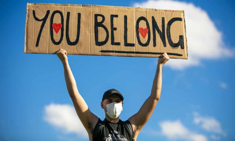 A man holding a banner