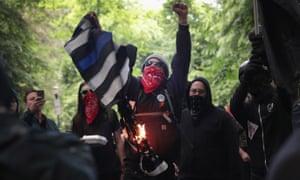 Antifascist demonstrators burn a Blue Lives Matter flag during a protest in June 2017 in Portland, Oregon.