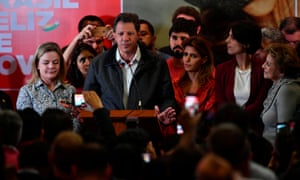 Workers' Party candidate, Fernando Haddad (C) speaks after the first round of the general elections in Sao Paulo.