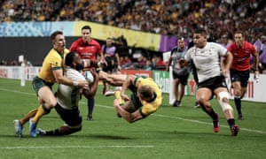 Australia's Reece Hodge high tackles Fiji's Peceli Yato at Sapporo Dome. Hodge was later cited and banned for the challenge.