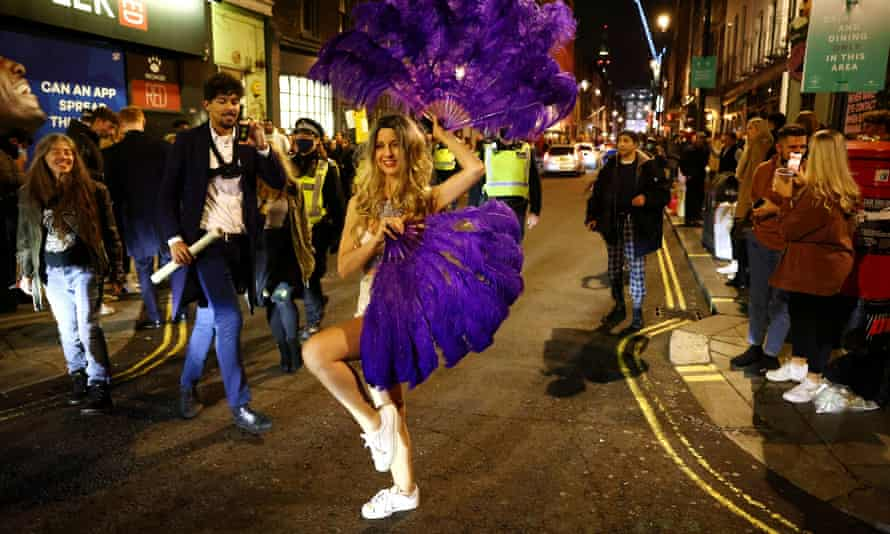 People partying on a street in Soho, London, 15 December 2020.