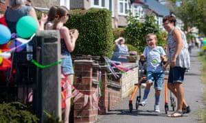 Nine-year-old Tobias Weller completing the final leg of his walking marathon.