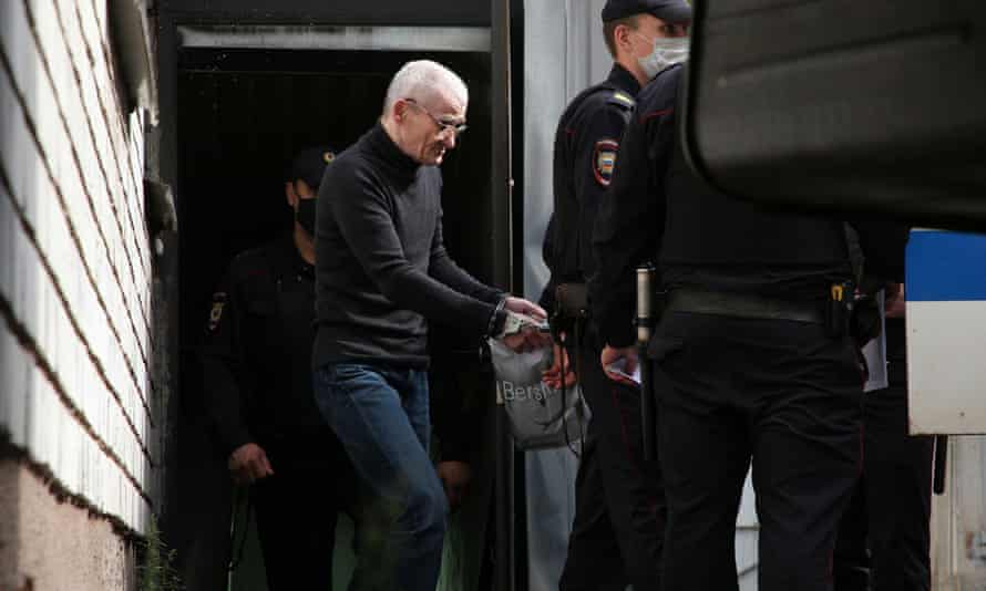 Russian historian Yury Dmitriev is escorted by police officers after a court hearing in July.