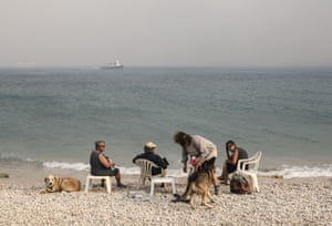 Residents evacuate to the seaside in the town of Kineta near Athens