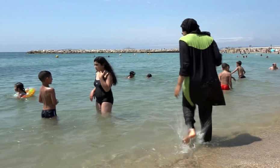 Nissrine Samali, 20, gets into the sea in Marseille wearing a burkini