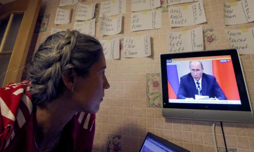 Woman watches Russian news programme