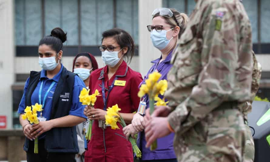Minute's silence at St Thomas' hospital, London, as part of the National Day of Reflection