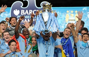 13 May 2012: Kompany celebrates with the Premier League trophy after City beat Queens Park Rangers thanks to Sergio Agüero's late winner on the final day, securing the league title for the club for the first time since 1968.