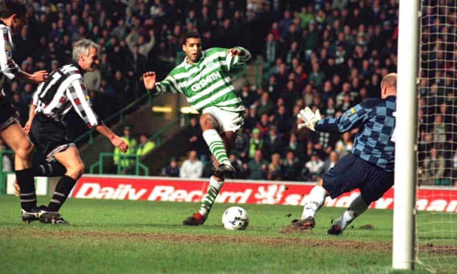 Pierre Van Hooijdonk beats Dunfermline keeper Ian Westwater to score for Celtic in 1996.