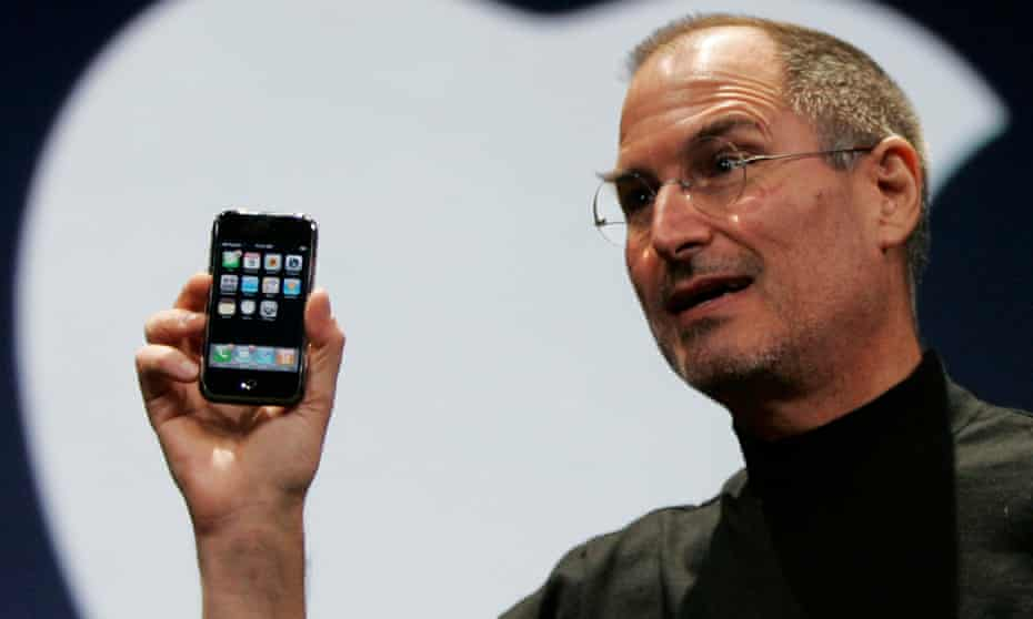 Steve Jobs shows off the new iPhone in 2007.