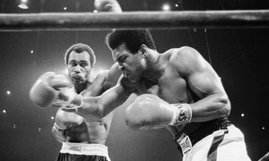Muhammad Ali (right) winces as Ken Norton catches him with a left hook to the head in their September 1973 rematch. Ali, who won the fight, spoke of 'the black lights' a fighter sees when hit by a concussive blow and suffered from Parkinson's disease later in life.