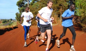 Adharanand Finn running with a group of Kenyans