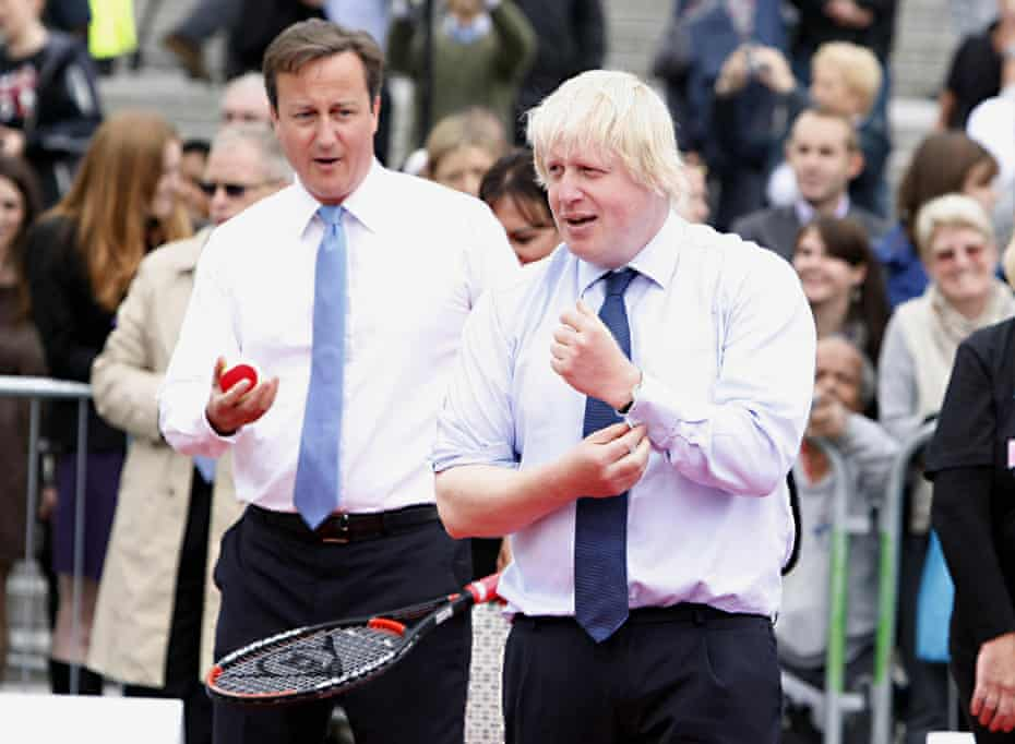 David Cameron and Boris Johnson prepare to play tennis during the International Paralympic Day in Trafalgar Square, London in 2011.