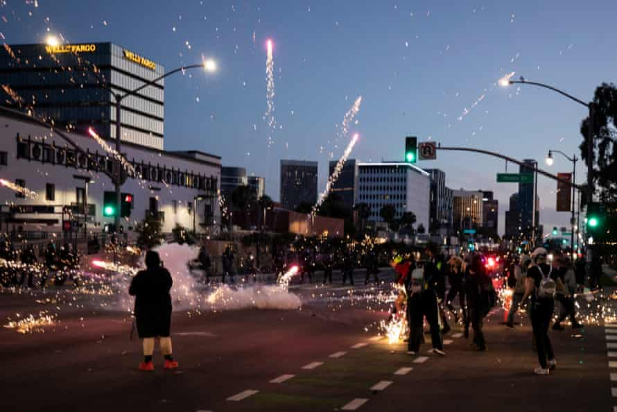 A flashbang explodes next to Black Lives Matter protesters as they face the police in Beverly Hills, California.