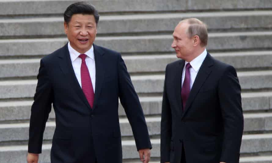 Xi Jinping and Vladimir at a Beijing welcoming ceremony for the Russian president in June 2016.
