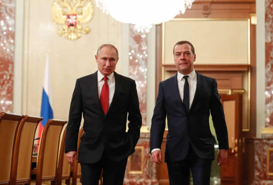 Vladimir Putin Dmitry Medvedev arive for a cabinet meeting on Wednesday